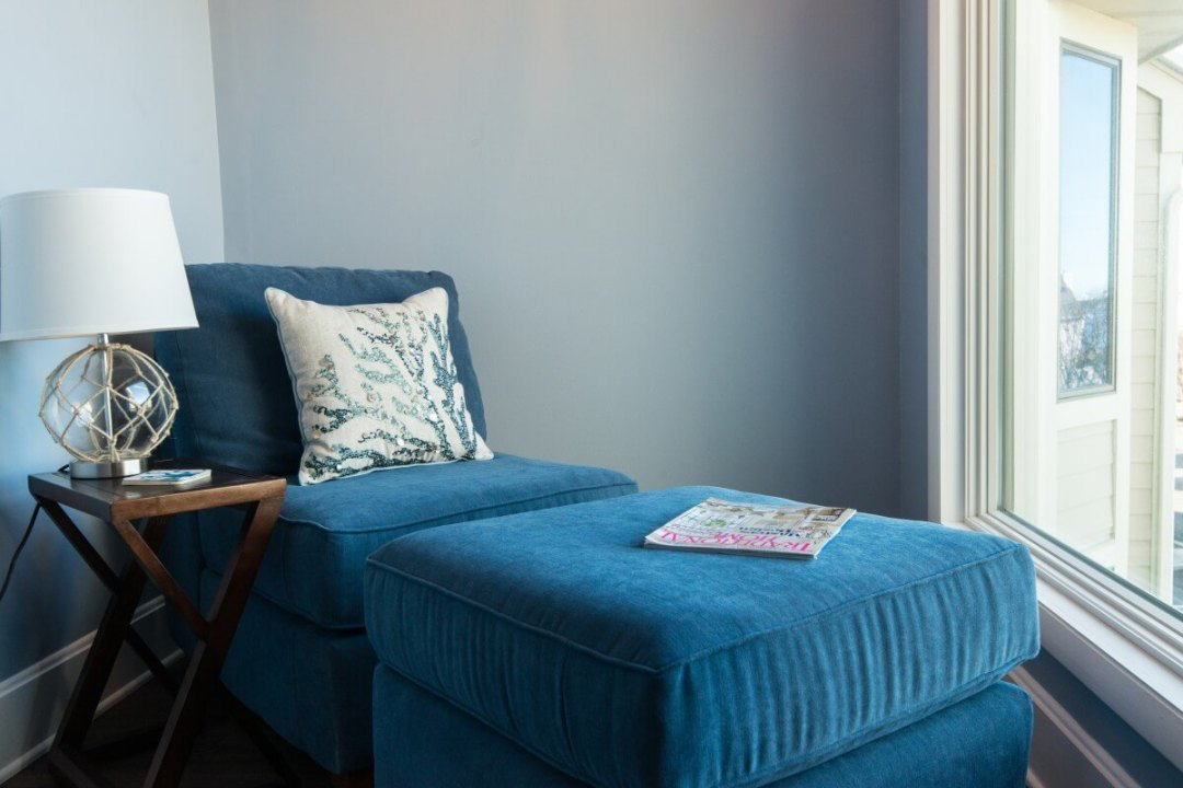 Kings Grant Renovation Vol.3 Fenwick Island, DE with Window Side Blue Fabric Lounge Chair and Foot Stool