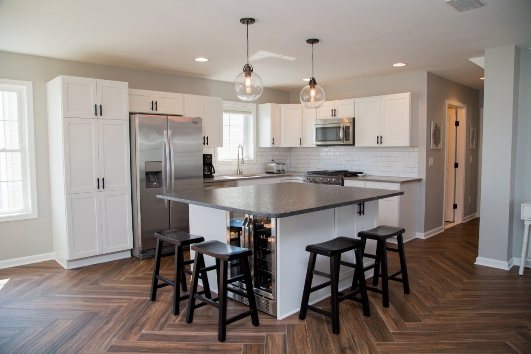 Kitchen Remodel with Center Island, Beverage Center and Dark Wood Bar Stools