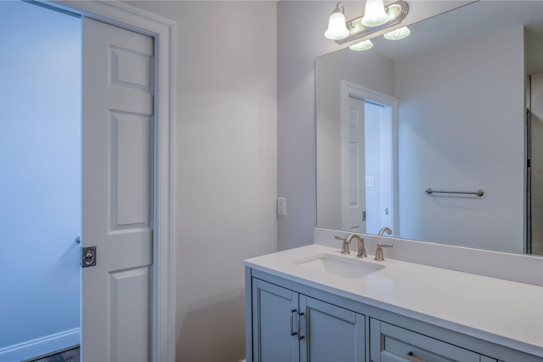 Bathroom Remodel in October Glory, Ocean View DE with Large Mirror and White Vanity Top