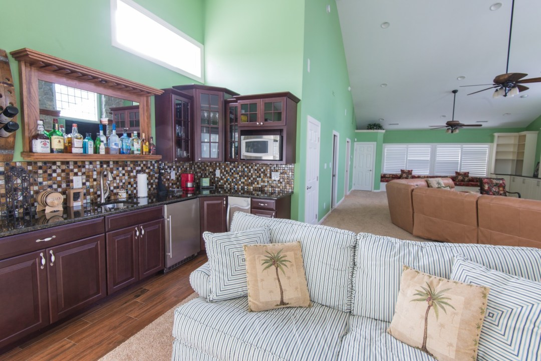 October Glory Great Room Addition in Bear Trap Dunes, Ocean View DE with Back Bar, Dark Wood Cabinets and Mirror