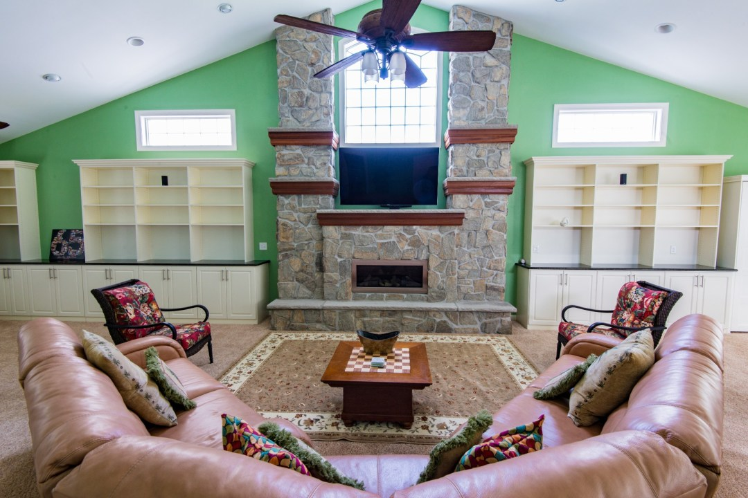 October Glory Great Room Addition in Bear Trap Dunes, Ocean View DE with Stone Gas Fireplace and Bookshelves