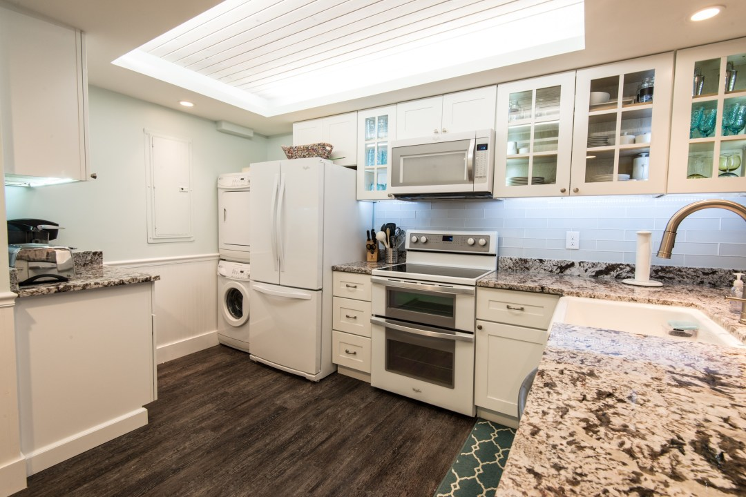 Kitchen Remodel in Sea Colony, Bethany Beach DE with Delicatus Granite Countertop, Glass Tiles Backsplash and Oak Wood Flooring