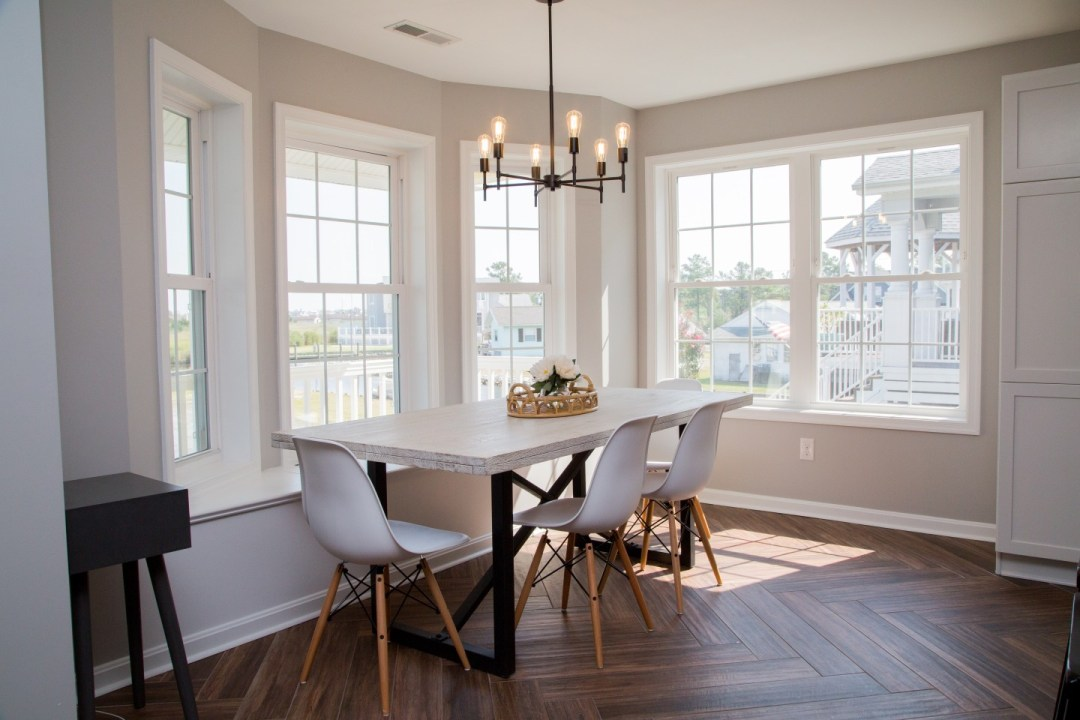 Kitchen Remodel with Window-Side Wooden Dining Table and White Chairs