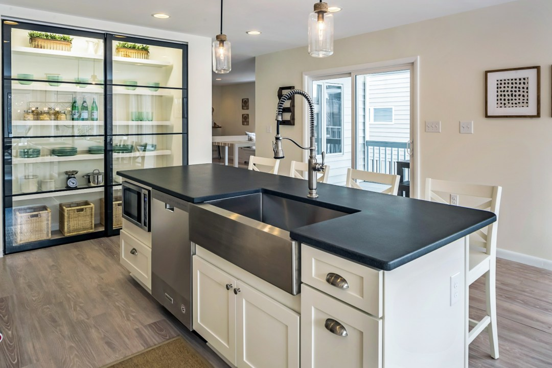 Kitchen Remodel in Wellington Parkway, Bethany Beach DE with Center Island with Black Countertop and Stainless Steel Sink