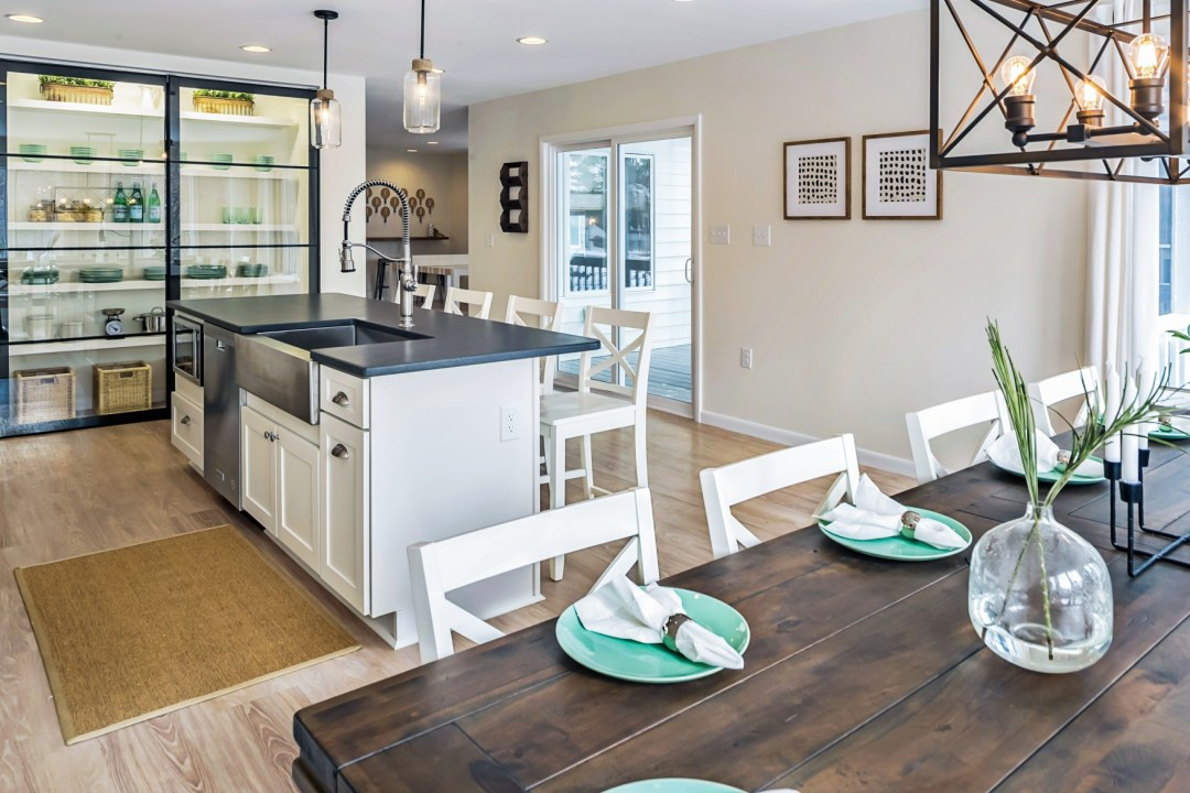 Kitchen Remodel in Wellington Parkway, Bethany Beach DE with Center Isle, Dining Table for Ten and White Wooden Chairs