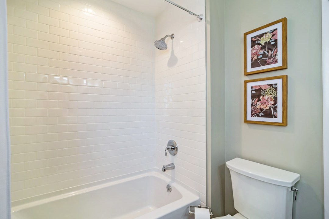 Bathroom with White Subway Tiles and Flower Paintings in Wellington Parkway, Bethany Beach DE Renovation