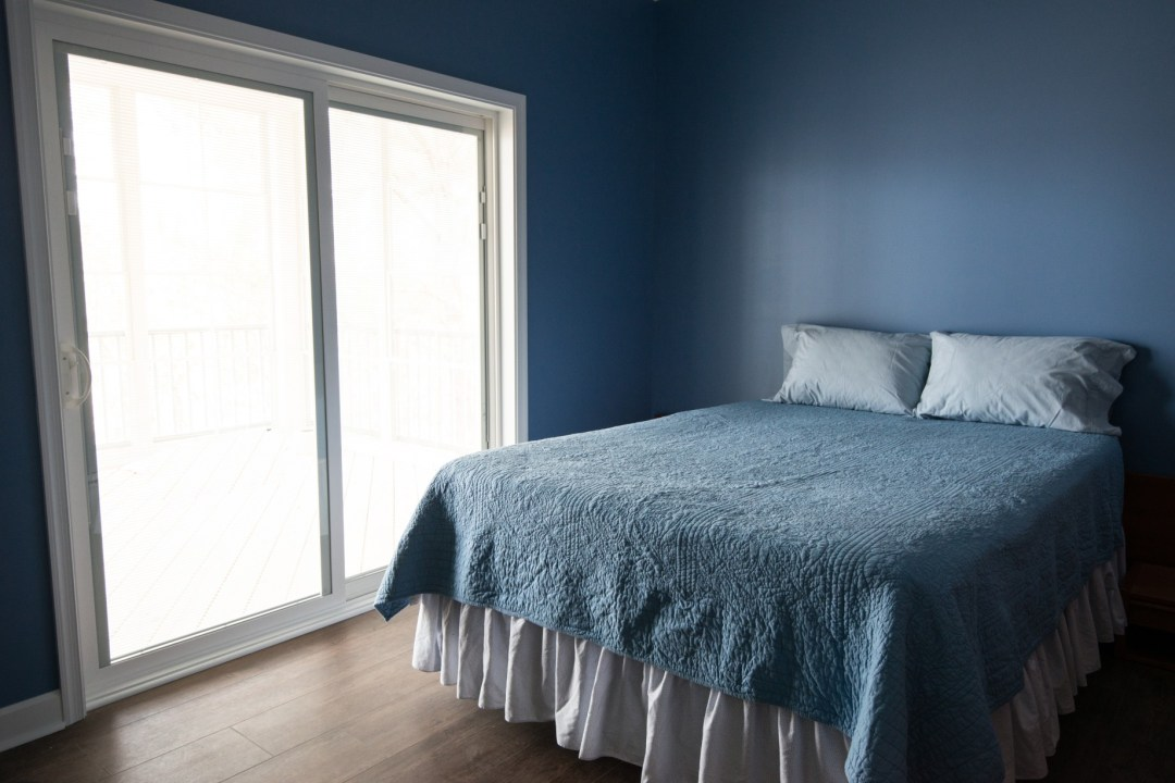 Whitesview Court House Lift New Addition in Ocean View DE Bedroom with Sliding Glass Doors and Blue Painted Walls