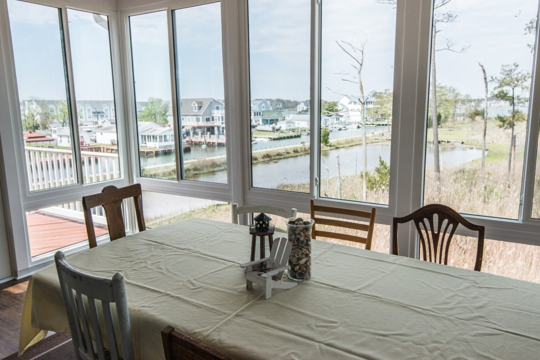 Whitesview Court Sunroom Vol.2 in Ocean View with White Sliding Glass Window Panels