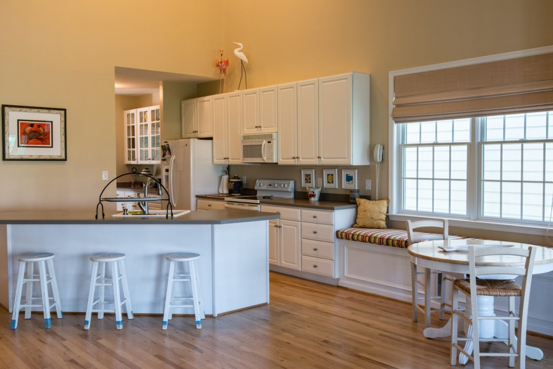 Willow Oak New Addition in Ocean View DE Kitchen Area with Center Island, Farmhouse Sink and Granite Countertop