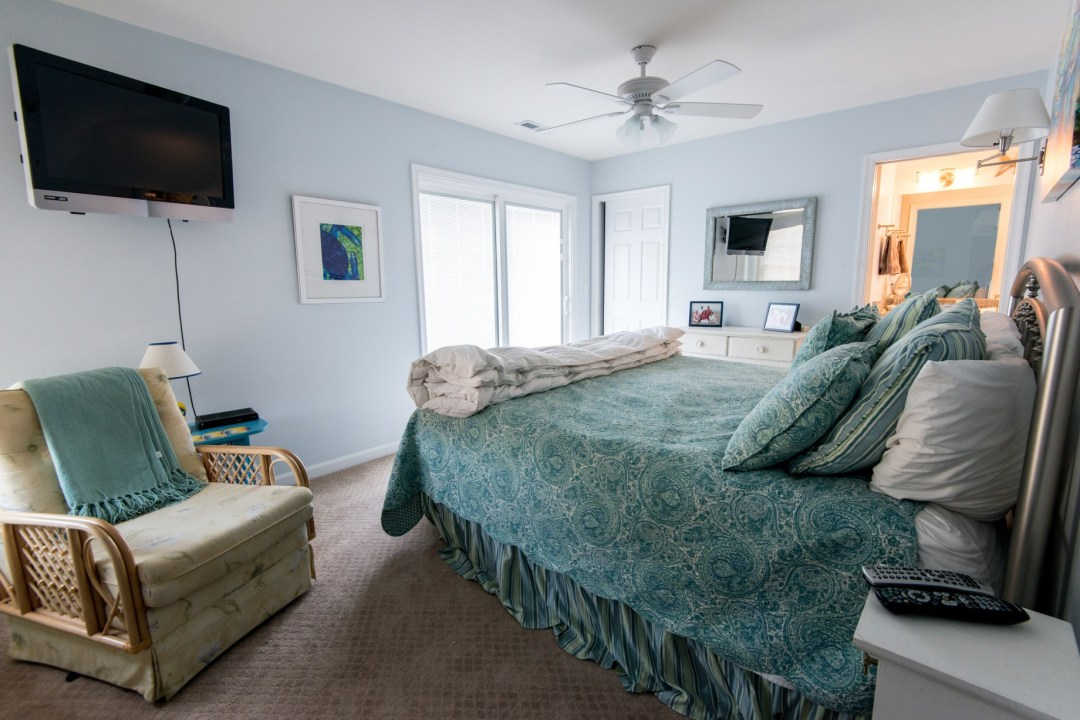 Willow Oak New Addition in Bear Trap Dunes, Ocean View DE Master Bedroom with Carpet, Wall Mount TV and Blue Painted Walls