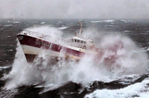 Fishing boat dancing on a rough sea