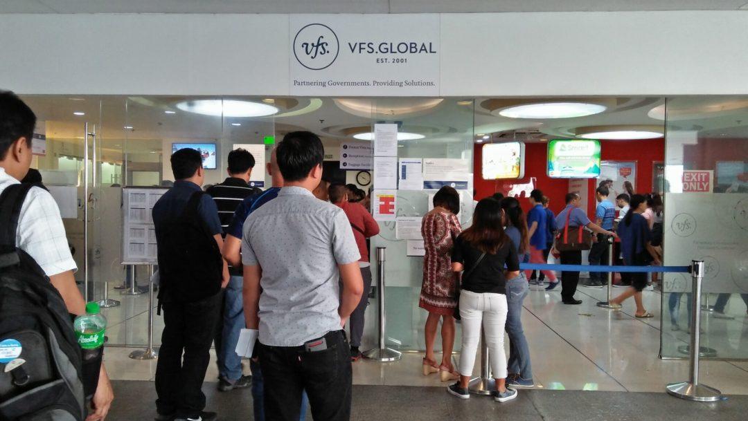 Falling in line outside VFS Global near the entrance