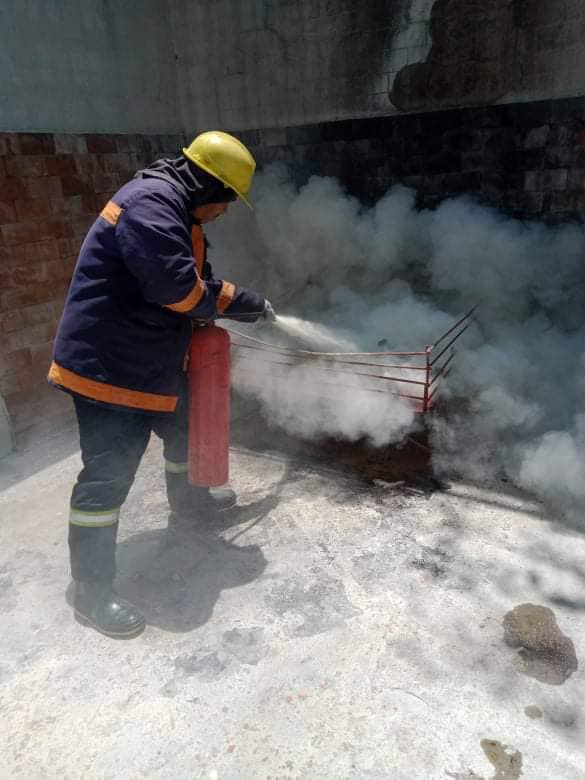 Firefighter extinguishing the fire using a fire extinguisher . This is in NOTIP- a Marina Accredited maritime training center.