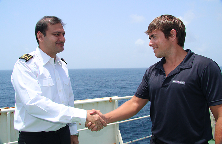 An Ambrey security personnel shaking hands with the Captain