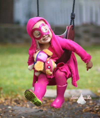 swinging in Skye Halloween costume Paw Patrol pink dog