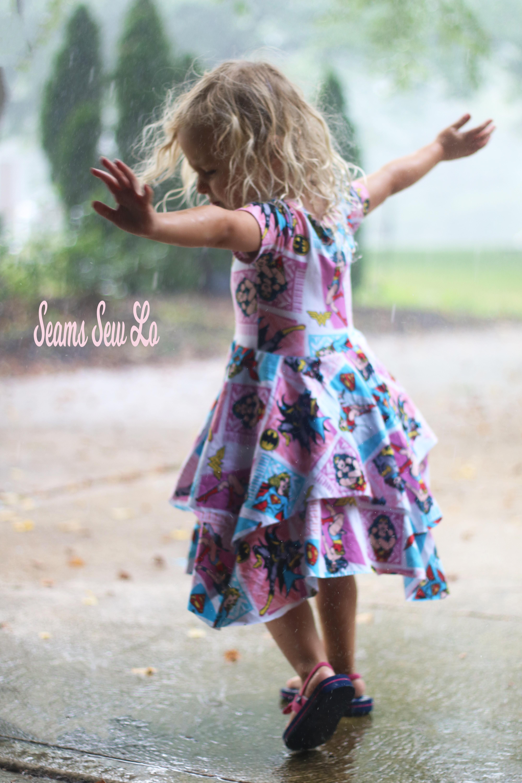 Little Girls Superhero Dress Dancing in the Rain