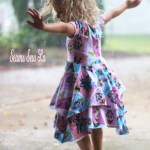 Little Girls Superhero Dress Dancing in the Rain