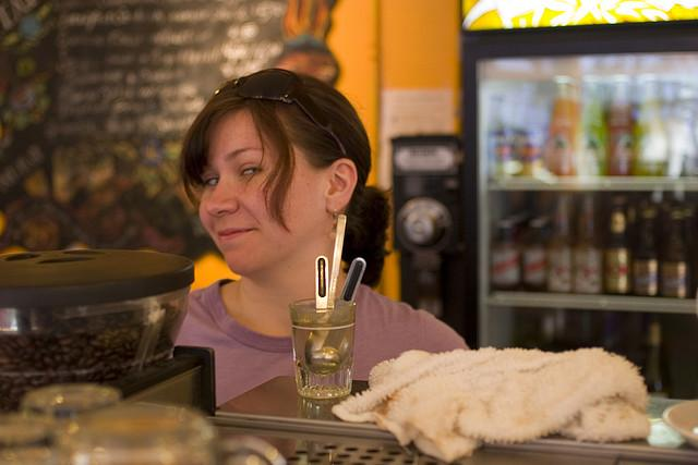 barista looking in the camera with a smile