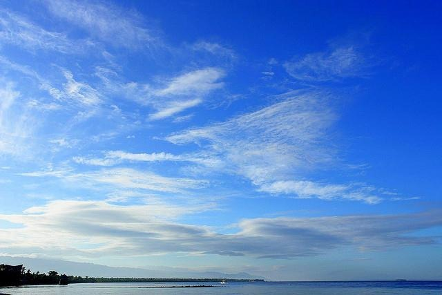 tropical image with blue skies, sea, island