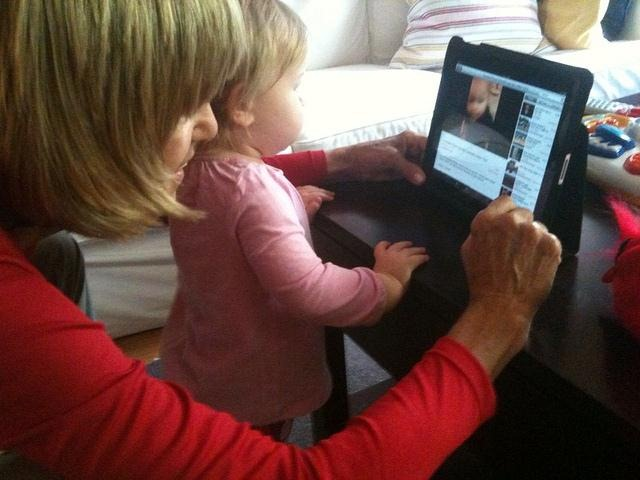 Mother & daughter watching videos on YouTube on an iPad