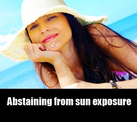 abstaining from sun exposure