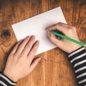 Image Of Girl Writing On A Blank Card At Her Desk - Search Influence