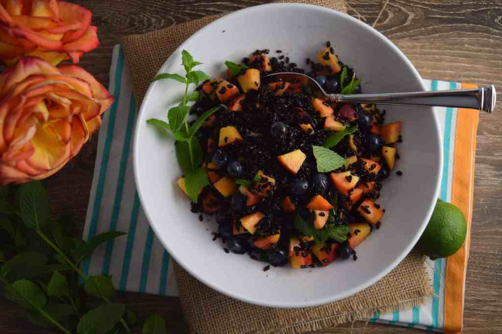 Black Rice With Peaches and Blueberries with spoon