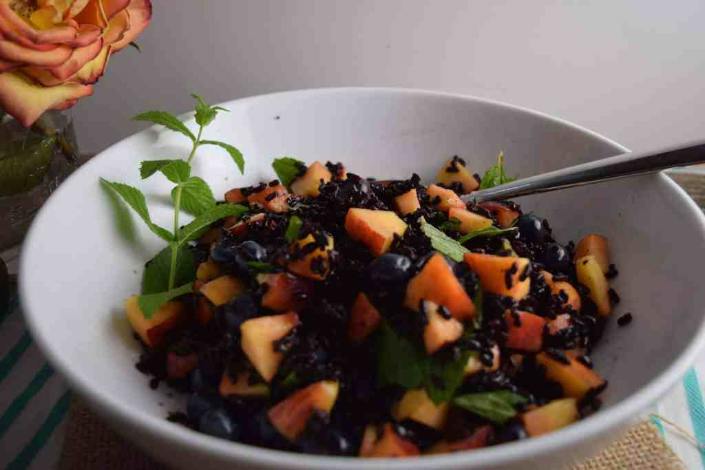 Black Rice With Peaches and Blueberries in bowl