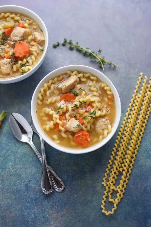 Instant Pot Chicken Soup in a white bowl