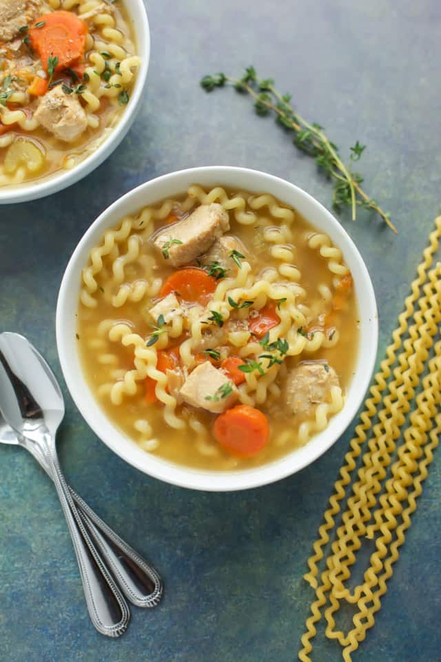 Instant Pot Chicken Soup in a white bowl with pasta