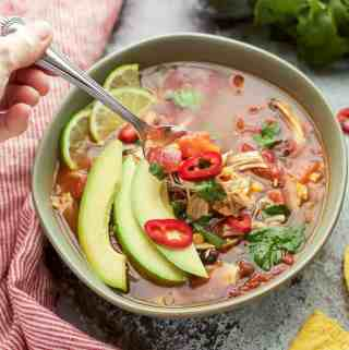 Easy Instant Pot Chicken Tortilla Soup is loaded with corn, chicken and beans. #glutenfree