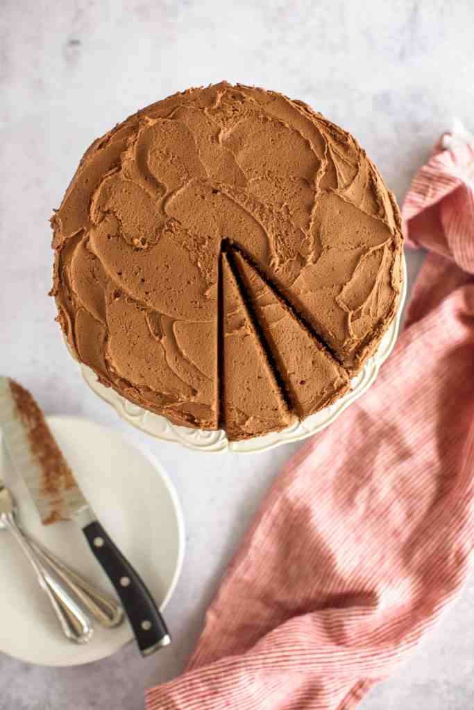 gluten free chocolate cake recipe with two slices cut from the top