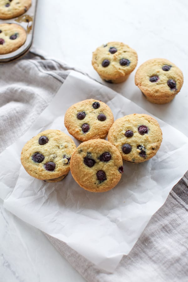 keto blueberry muffins on parchment paper