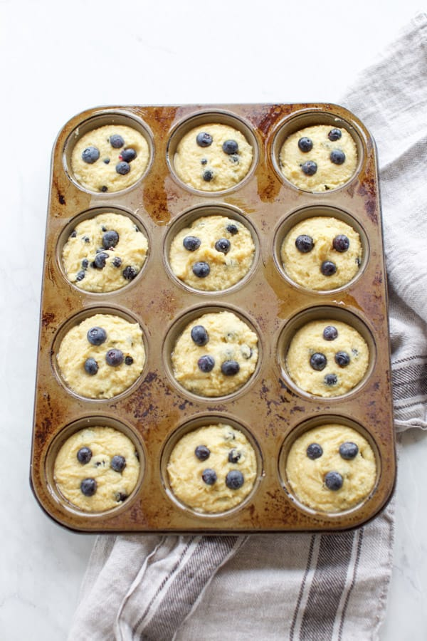 almond flour blueberry muffins in a muffin tin