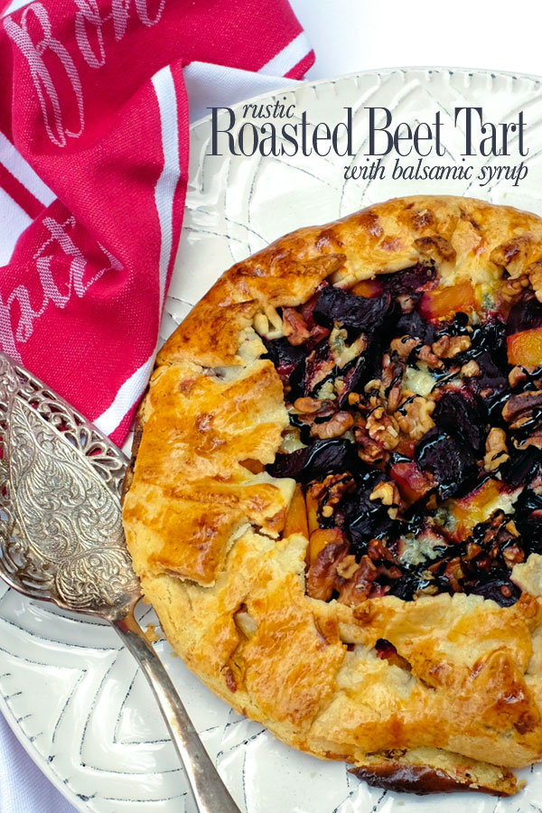 Savory and delicious — a roasted beet and goat cheese tart baked in a free-form flaky crust. Topped with walnuts and a drizzle of balsamic syrup| seasonalmuse.com