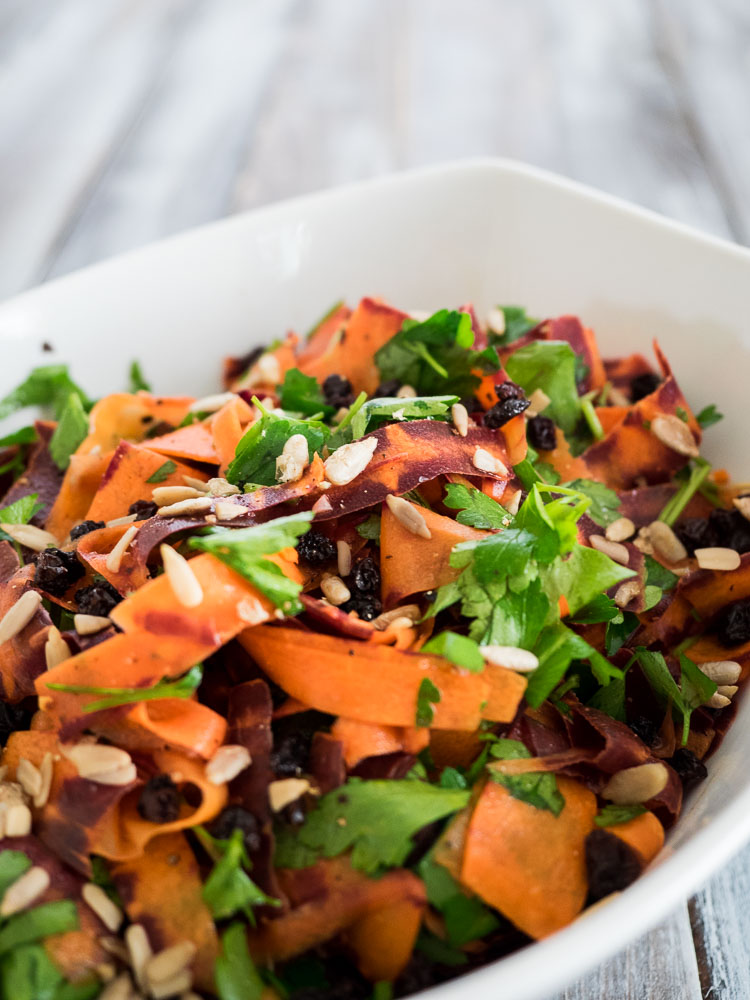 Shaved Carrot Salad | A light and easy carrot salad with lemon juice, parsley, sunflower seeds and dried currants. Perfect as a vegan, gluten free side dish any time of the year. | seasonedvegetable.com