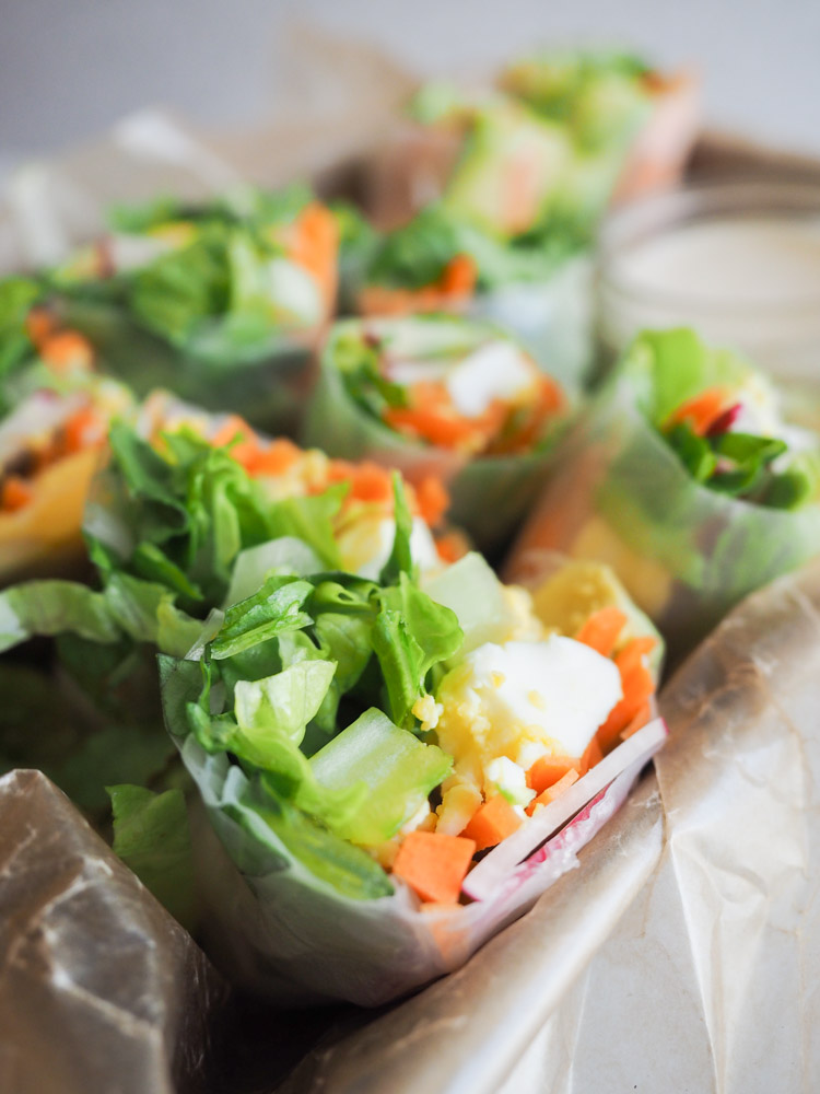 Caesar Salad Spring Rolls | These fresh caesar salad spring rolls are filled with crunchy vegetables and paired with an easy, savory miso caesar dressing. Perfect for a light lunch or appetizer! | SeasonedVegetable.com