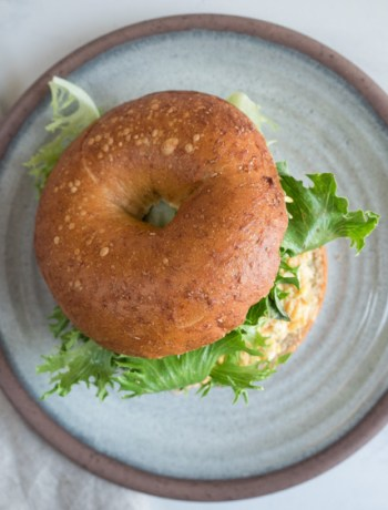 Egg Salad Bagel Sandwich | An easy bagel sandwich with egg salad that's perfect for lunch! Bagels, egg salad, lettuce, and voila!- a sandwich. | SeasonedVegetable.com