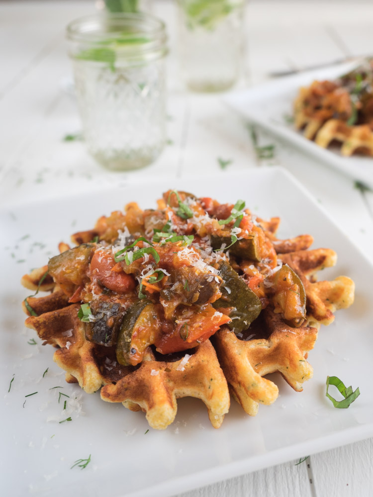 Roasted Vegetable Ratatouille and Waffles | An easy roasted vegetable ratatouille uses the bounty of summer produce. Seasoned with fresh basil and served atop crispy, herby cornmeal waffles. | SeasonedVegetable.com