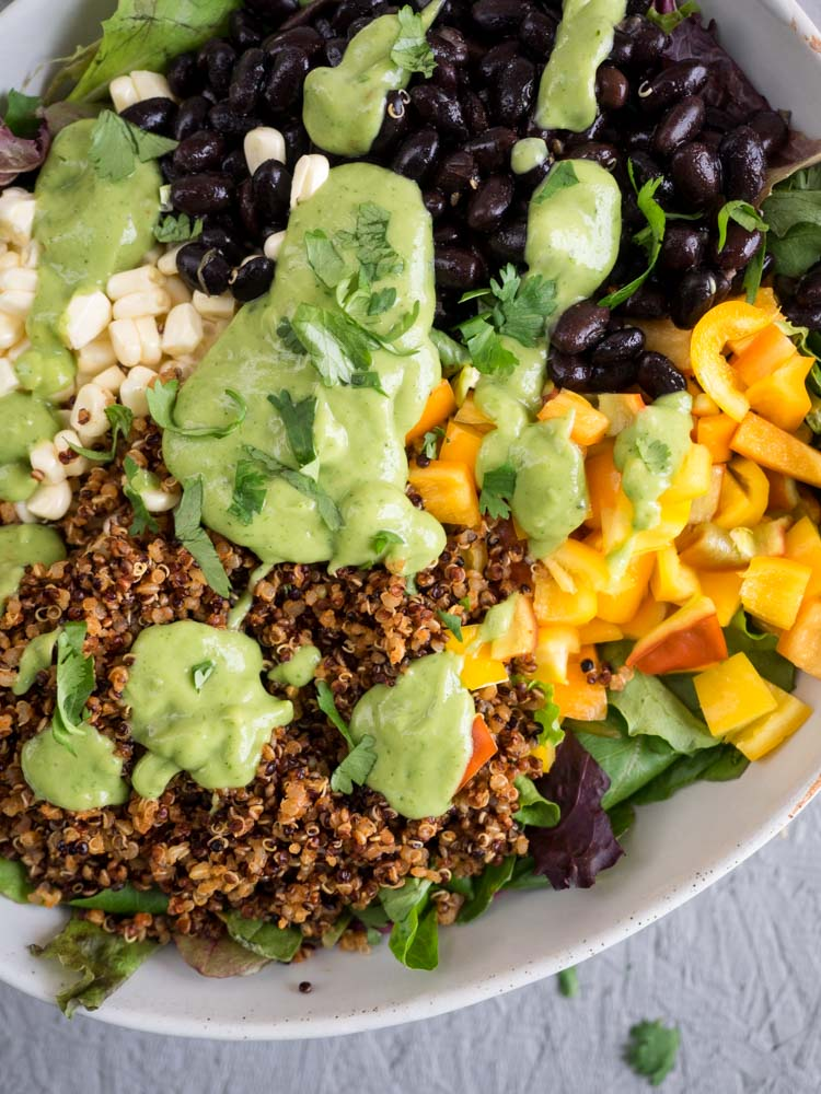 Quinoa Taco Salad | A quick, easy quinoa taco salad served with avocado cilantro dressing. Topped with crunchy bell peppers and savory black beans, it's a delicious lunch or light dinner. | SeasonedVegetable.com #glutenfree #vegan
