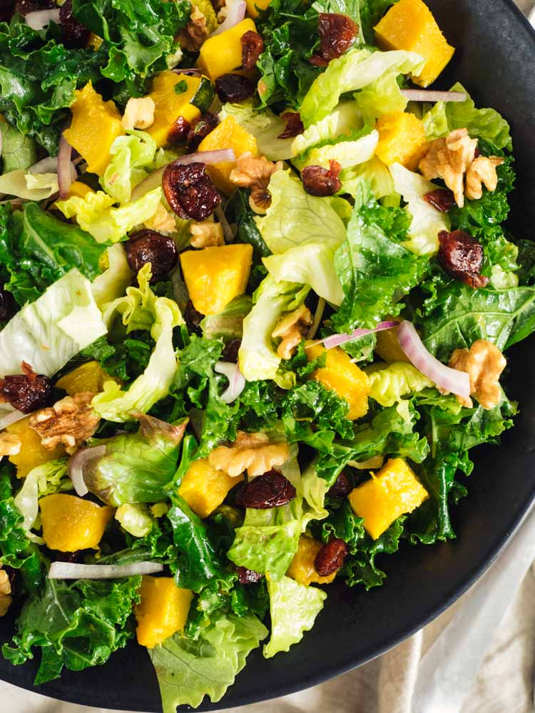 Roasted Acorn Squash Kale Salad | A roasted acorn squash kale salad with an orange vinaigrette dressing is perfect for winter lunch or dinner. Vegan, gluten free, paleo and Whole30 friendly. | SeasonedVegetable.com #wintersalad #veganrecipe #glutenfreerecipe #winterrecipe #vegetarianrecipe #vegetariansalad