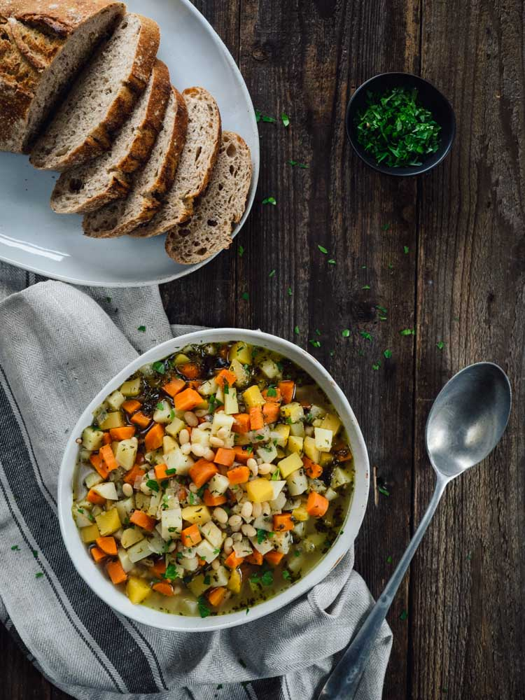 White Bean Root Vegetable Soup | This root vegetable soup with white beans brings together humble ingredients for an easy, flavorful and hearty soup. Perfect for cold winter nights. | SeasonedVegetable.com #soup #vegetarianrecipe #souprecipe #rootvegetables