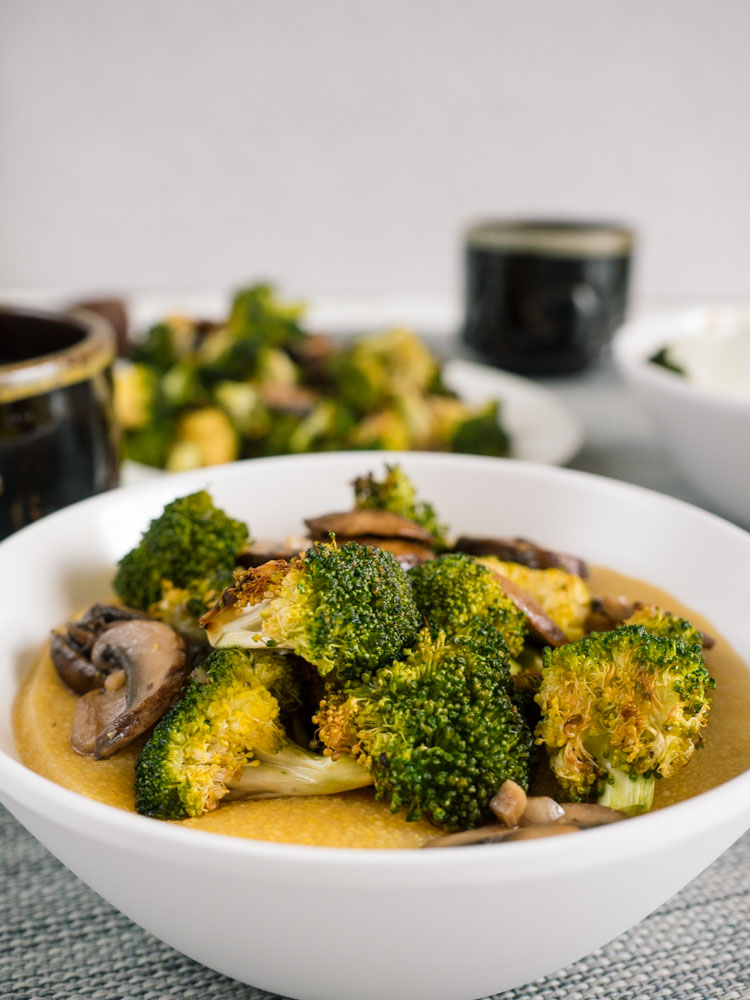Breakfast Polenta Bowl | Breakfast polenta is an easy recipe to feed a crowd. This vegan and naturally gluten free recipe features roasted broccoli and mushrooms atop creamy polenta. | SeasonedVegetable.com #breakfast #vegan #recipe #vegetarianrecipe #polenta