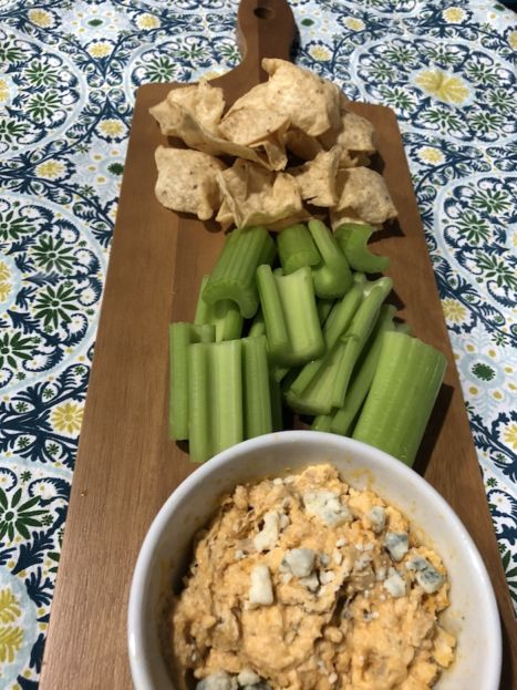 Buffalo Chicken Dip with celery and chips (A Seat at the Table)