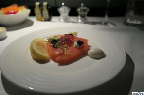 Mid-flight snack of smoked salmon with caviar on Emirates