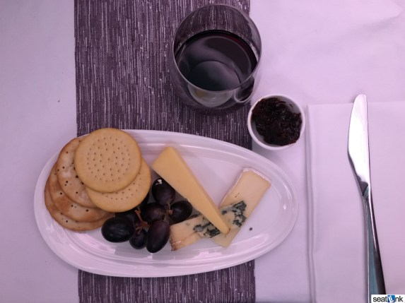 The Upper Class cheese plate with a glass of Port