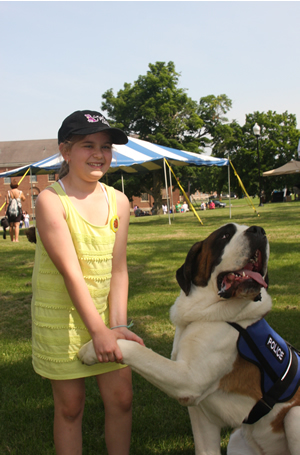 Samantha Kuruc is all smiles while enjoying some bonding time with Clarence, a St. Bernard, owned by Bill and Laura Gordon, of Greenfield, Mass. The couple, both members of the Greenfield police department, operates an organization called Canines Helping Autism and PTSD Survivors. Their two St. Bernards, Clarence and Rosie, also compete in conformation shows in the Northeast.