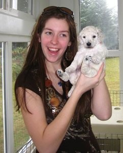 Kaitlyn Jones is all smiles when holding puppy Ally several years ago.