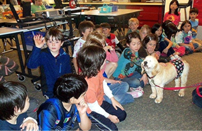 Francis helps a class of kids learn how old dogs make great pets.