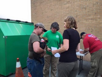 WASART volunteers check a lost dog into its temporary shelter. Photo from WASART.